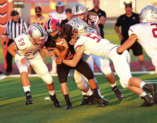 Bear River's Jared Baze and Sam Davis take down a ball carrier during the Bruins 49-0 victory over Pershing County (Lovelock, Nevada).