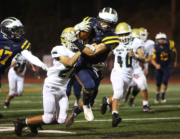 Nevada Union running back Logan Lopez (44) breaks through tackles as he moves the ball towards the end zone during Friday's 59-34 win over the Napa Grizzlies.