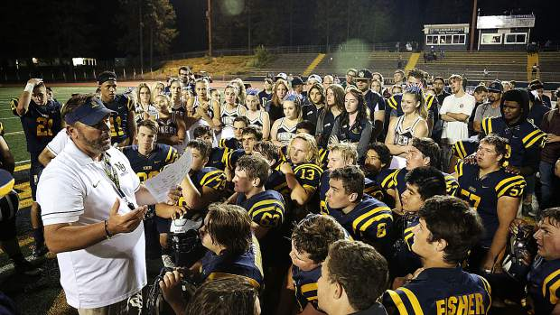 Nevada Union Miners varsity head coach Brad Sparks celebrates his first win as head coach along with his players and members of the community who cheered them on Friday night from Hooper Stadium at Nevada Union High School.