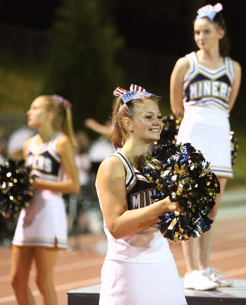 The Nevada Union Miners cheer leaders keep smiles on their faces throughout Friday night's high scoring matchup between the Miners and the Napa Grizzlies.