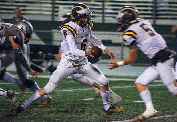 Nevada Union's Parker Heilaman hands teh ball to Dawson Fay during a game against Ponderosa Friday night.