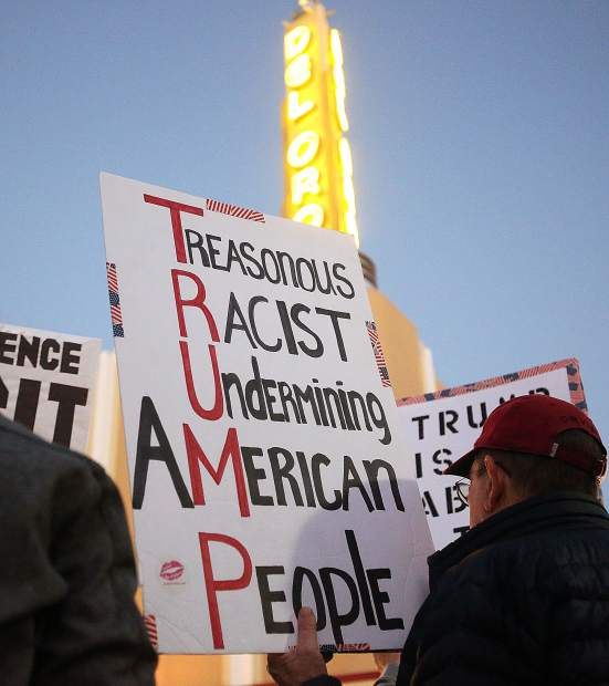 Nevada County protesters descended upon downtown Grass Valley Thursday evening, to show their concern for the firing of former U.S. Attorney General Jeff Sessions by President Donald Trump.