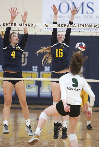 Aragon and Dunbar watch as a Miramonte spike sails past them.