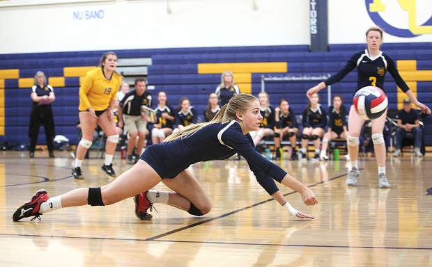 Nevada Union senior Bekah McGill makes a dive to save a hit from NorCal D-III playoff opponent Miramonte Thursday evening in Grass Valley. Despite the efforts of McGill and the rest of the team, the Lady Miners would fall to the Matadors in 5 sets.