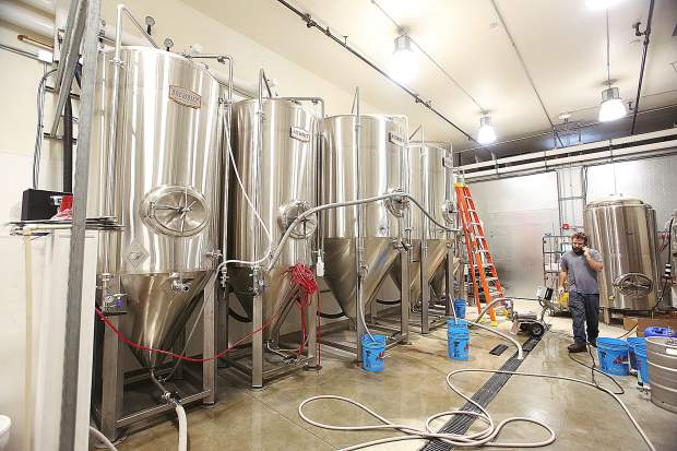1849 Brewing Co. brewer and co-owner Kevin Krikorian takes business phone calls Tuesday morning from the brewery.