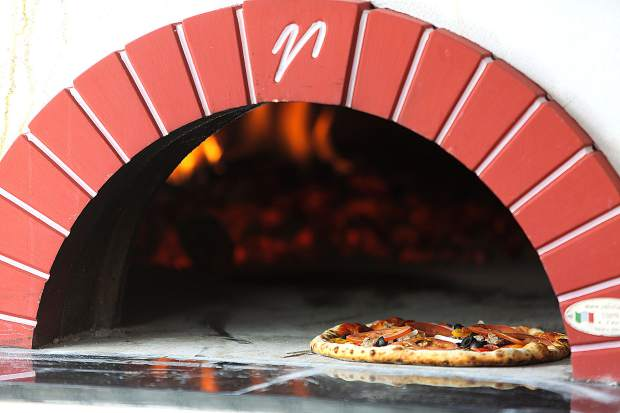 A wood fired combination pizza is cooked and ready to go from 1849 Brewing Co.