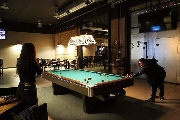 Thomas Bayne and Eleanor Kelly enjoy a game of pool Monday night at 1849 Brewing Co.
