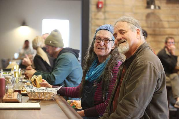 Stephanie Cole and Marvin Skadsheim enjoy a beverage and a bite to eat Tuesday morning at 1849 Brewing Co.