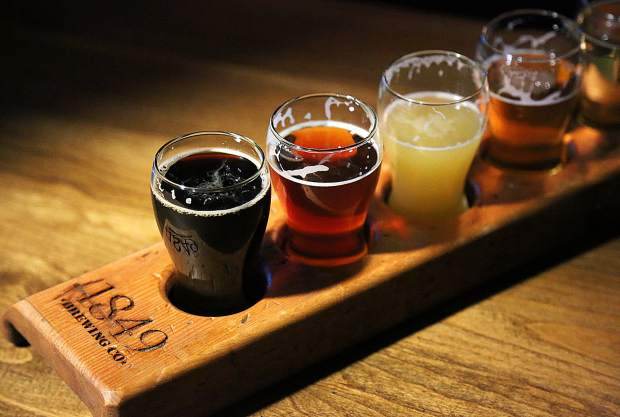 A flight of beers from 1849 Brewing Co. include Gravity is Real (from left), Full Steam Ahead, North Church Street Hazy IPA, House Ale, and the Del Oro Mexican Lager.