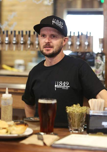 Bartender Andy Jarrett serves from 1849 Brewing Co. full bar, serving local wines and hard alcohol on top of their in house-brewed beers.
