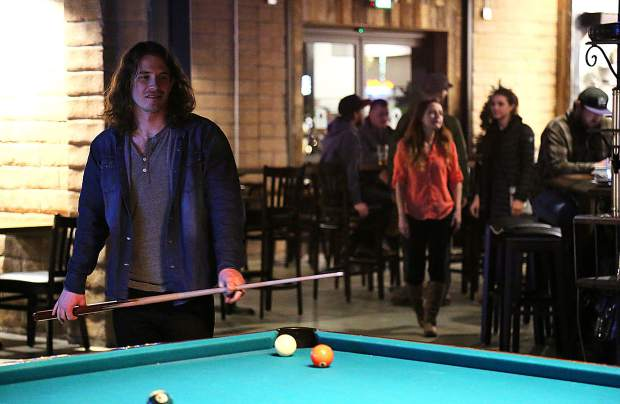 Thomas Bayne lines up a shot on the billiards table at 1849 Brewing Co. Monday night in Grass Valley's Glenbrook Basin.