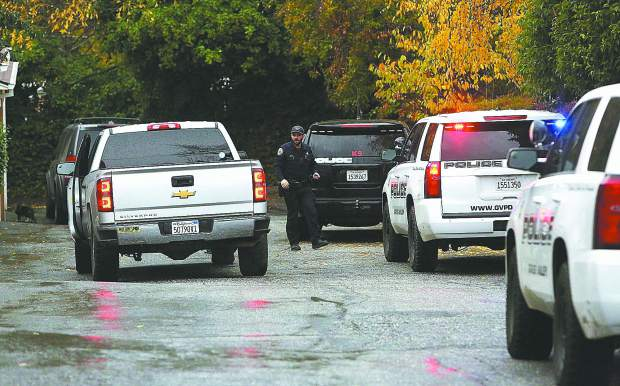 Police vehicles fill the driveway of an apartment complex on the 300 block of Pleasant Street in Grass Valley following Tuesday's armed robbery.