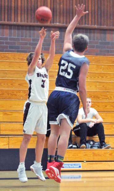 Bear River's Brekyn Vasquez puts up 2 points while Forest Lake Christian's Chris Papera defends his shot.