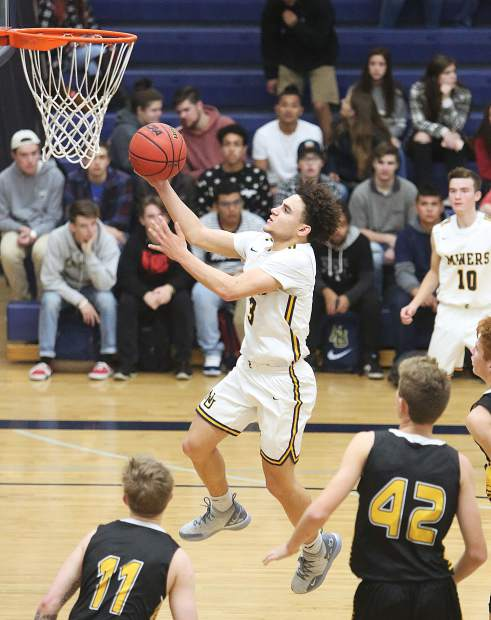 Nevada Union's Riley Japhet-Gekas goes up for two of his eight points in the Miners 66-64 win over Enterprise in the Nevada Union Invitational Tournament opener Thursday at Albert Ali Gymnasium.