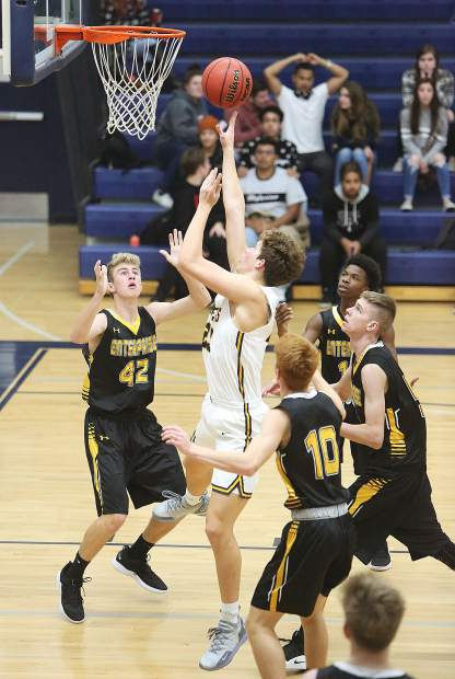 Nevada Union's Milo Goehring scored 16 points and pulled down 10 rebounds in the Miners 66-64 win over Enterprise in the Nevada Union Invitational Tournament opener Thursday at Albert Ali Gymnasium.