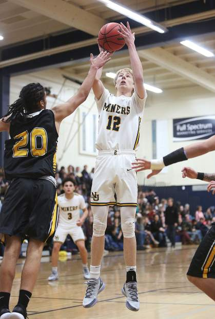 Nevada Union's Ty Daugherty goes up for two in the Miners 66-64 win over Enterprise in the Nevada Union Invitational Tournament opener Thursday at Albert Ali Gymnasium.