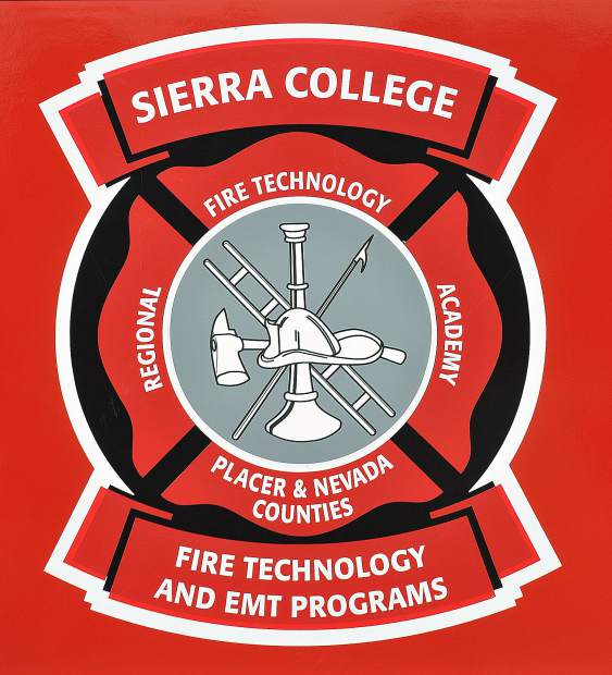 The Sierra College Fire Technology and EMT Program emblem sits on the door of one of the fire academy's training engines.