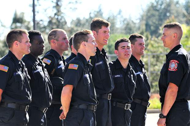The first set of Sierra College Fire Academy students stand at attention during Tuesday's ribbon cutting ceremony of the recently completed Fire Apparatus Building. The college plans to expand on their facilities at the regional public safety training center, including construction of a fire tower.