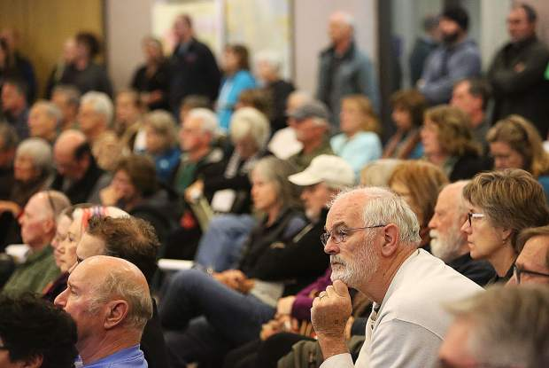 A standing-room-only crowd listens intently to the statements and warnings provided by area firefighters and law enforcement officers during Wednesday evening's Wildfire Town Hall meeting at the Rood Government Center.