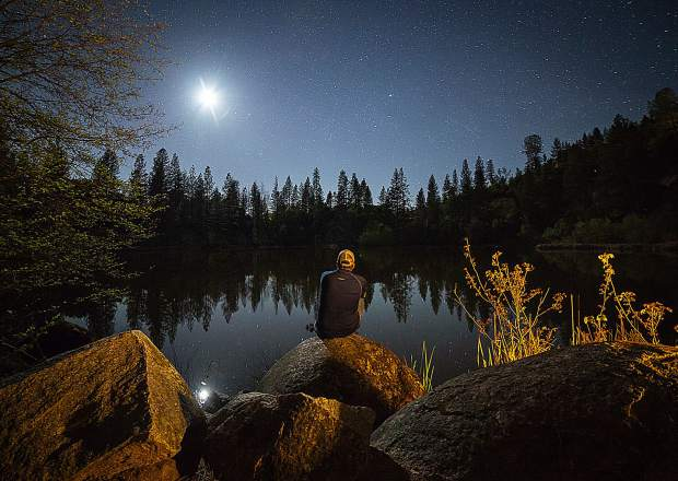In a rare self portrait, Kial James looks over Hirschman Pond in Nevada City.