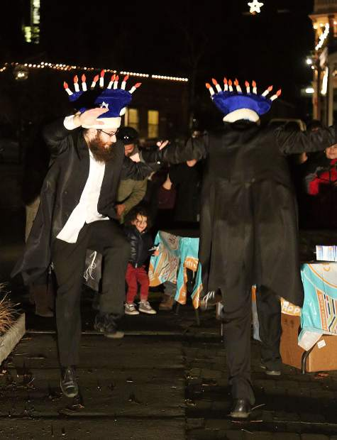 Bentzion Sheinberger and Mendel Wineberg from Brooklyn, New York, make up the duo of The Dancing Rabbi's, who performed in front of Thursday evening's menorah lighting ceremony.
