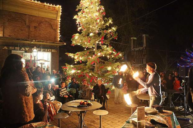 Grass Valley's Barry Friedman is asked to take on some fire juggling for the crowd during Thursday's menorah lighting ceremony in Nevada City.
