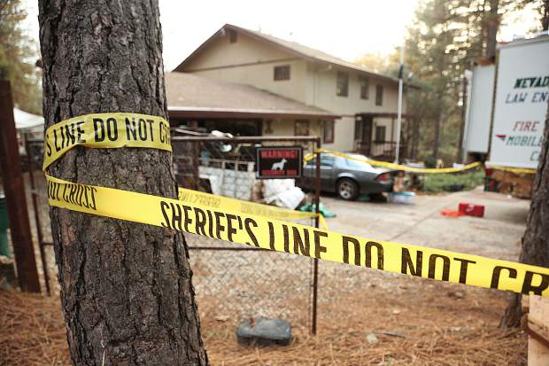 Police tape surrounds a home on Lawrence Drive in Alta Sierra where an investigation into a missing man continues Wednesday evening.