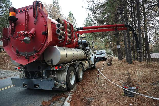A vacuum truck arrives on scene to work the Oscar Dr and Lawrence Way crime scene in Alta Sierra Wednesday.