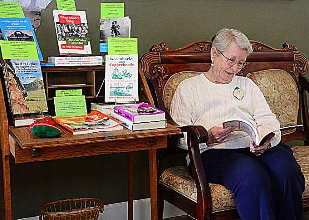 Pat Chesnut of the Searls Library enjoying the history books available in the lobby of the History Center, located in Nevada City at 161 Nevada City Hwy.