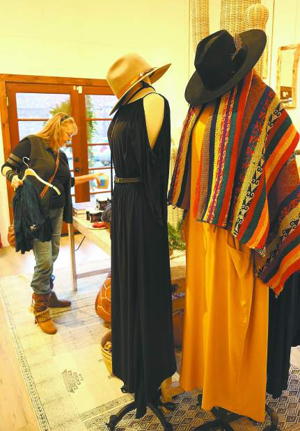 A shopper peruses through some of the many items for sale at TYSA in downtown Nevada City after their opening Thursday evening.