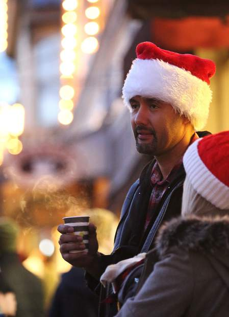 Yuba City's Dewayne Debbs sips on a cup of hot mulled wine along Broad Street Sunday evening during Nevada City's Victorian Christmas. Wednesday night, from 6 to 9 p.m., is the next scheduled Victorian Christmas this holiday season.