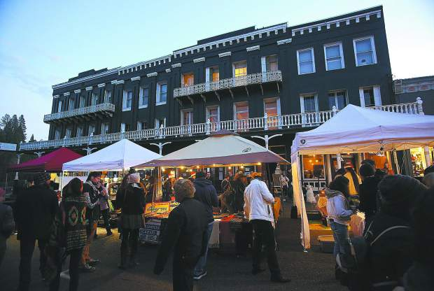 The historic National Exchange Hotel looms behind Sunday's Victorian Christmas street faire, closed for the first time during the event in many years. The hotel's new owner Jordan Fife had hoped to have the remodeled building re-opened by the first Victorian Christmas of 2018. Fife has since revised the target opening date to spring/summer of 2019.