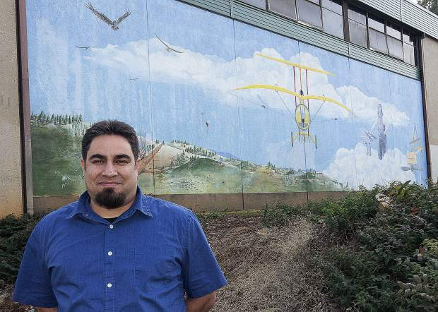 Patrick Brose, the new principal of Lyman Gilmore School in Grass Valley, stands in front of the school's mural Wednesday afternoon.