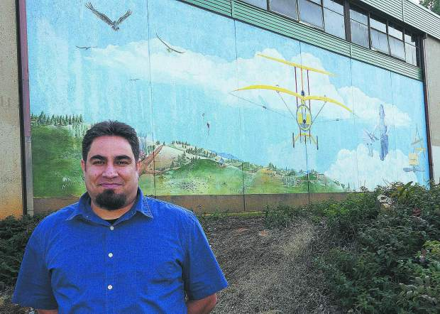 Photo by John Hart Patrick Brose is the new principal of Lyman Gilmore School, Gilmore Way, Grass Valley, standing in front of the school's mural in front of the school, Wednesday afternoon.
