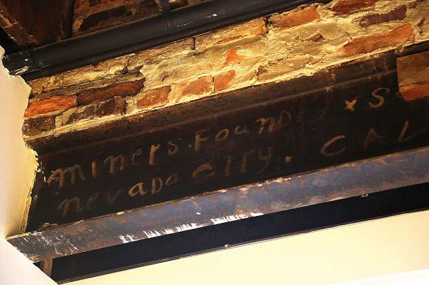 An original Miners Foundry beam sits exposed from within City Council.