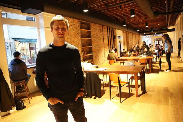 Josh Henry stands in one end of his new downtown Nevada City coffee shop, City Council, which offers visitors many different seating options.