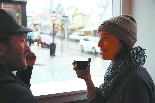 Clara Zahorsky readies to take a sip from her latte Wednesday at City Council coffee shop in downtown Nevada City.