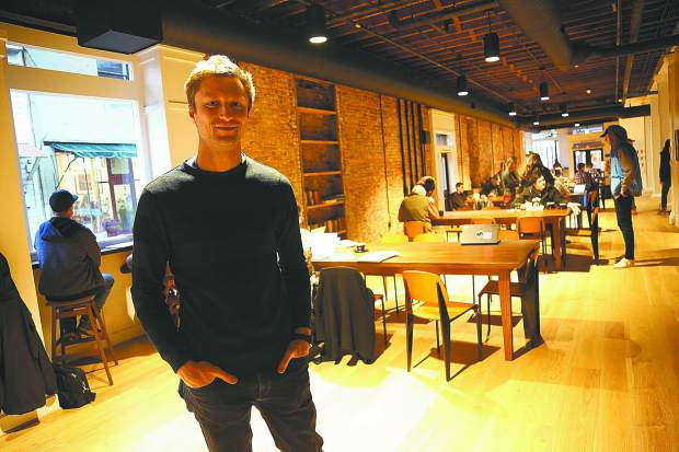 Josh Henry stands in one end of his new downtown Nevada City coffee shop,