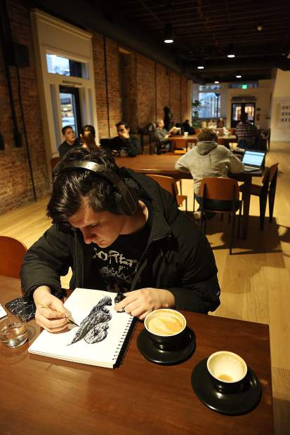 Rough and Ready's Daniel Hart makes a pen and ink creation while enjoying a latte Wednesday afternoon at City Council, now open on Broad Street in Nevada City.
