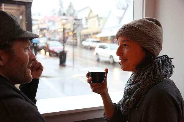 Clara Zahorsky readies to take a sip from her latte Wednesday at the new City Council coffee shop in downtown Nevada City along with friend Eros Buteo.