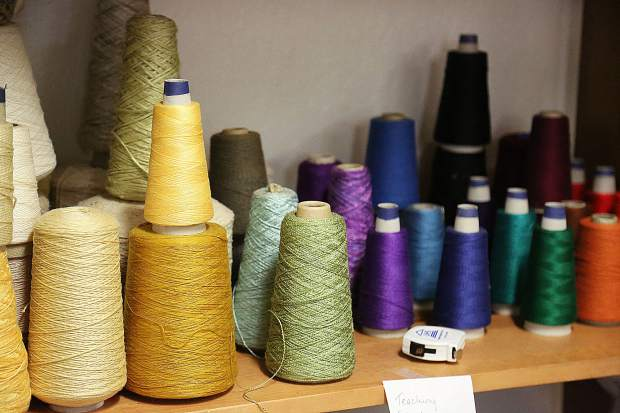 Colorful spools of yarn and thread fill the shelves in Curious Forge's new Fiber Arts addition.