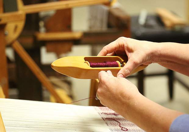 A shuttle is readied with thread to be used in a loom donated to the Curious Forge's new Fiber Arts program.