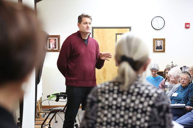 Nevada County Director of Housing and Child Support Services Mike Dent talks about the many unfortunate paths that can lead to homelessness to those in attendance of Saturday's League of Women Voters forum at Peace Lutheran Church.