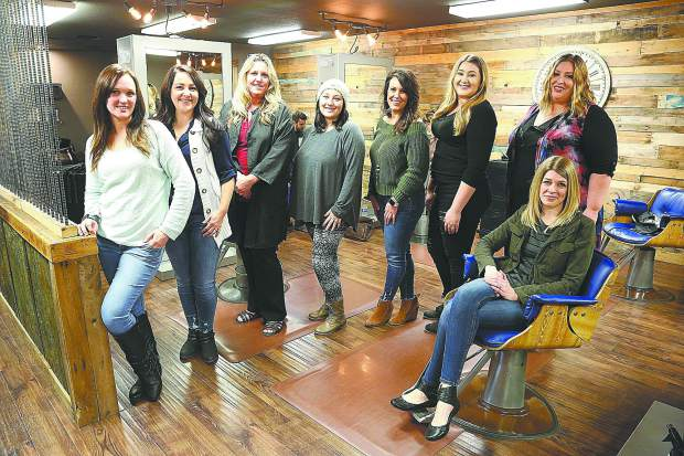 Hair Loft workers Kayla Schies (from left) Myranda Craw, Carolyn Harwood, Halie Phillips, Christie Fain, Jessica Parra, and Ashley Benham stand next to the space's owner Sarah Cranston last week.