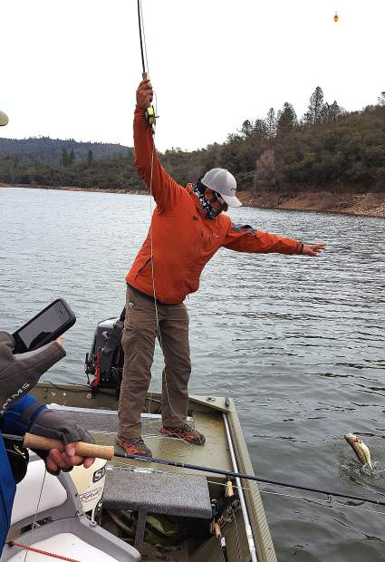 Tom Pages' client Alex Rameriz with landing a bass at Collins Lake.