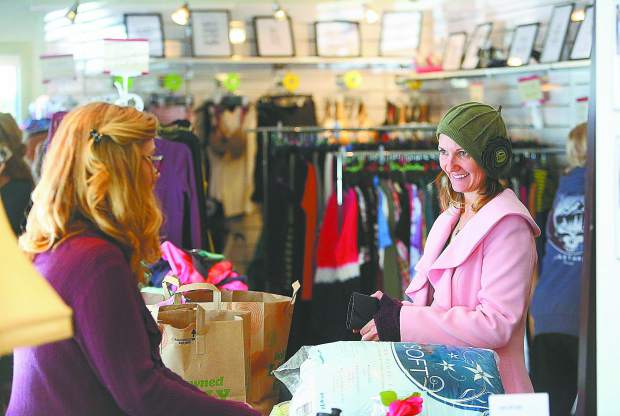Jessa Wind readies to make her purchases Thursday afternoon from the newly reopened Pets In Need Dollar Thrift Store space on Colfax Avenue.