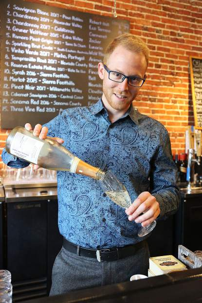 The Pour House bar manager Thomas Hall pours a glass of bubbly Friday afternoon in downtown Grass Valley.