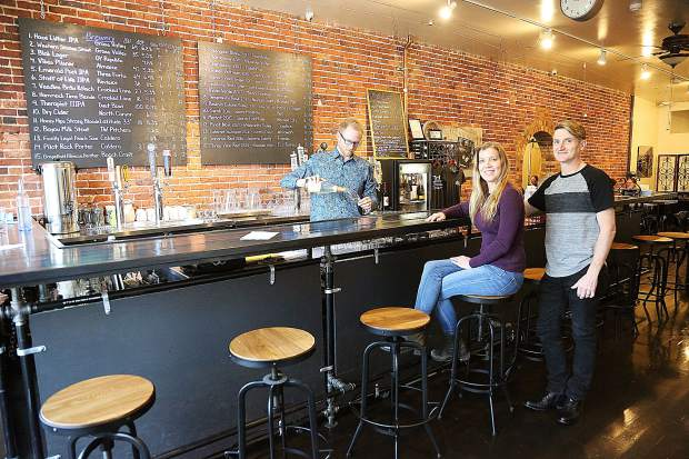 The Pour House owners Ryan and Teresa Thomas are served by bar manager Thomas Hall Friday afternoon at their new establishment on Main Street in downtown Grass Valley.