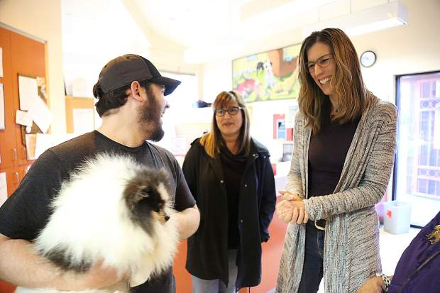 Sammie's Friends kennel attendant Evan Walsh holds a stray Pomeranian named Sir Fluff alongside new directors Lizette Taylor and Lorie Hennessey Wednesday at the shelter.
