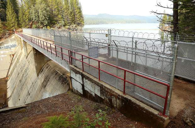 The Scotts Flat Dam and spillway as shown from the Cascade Shores side where a fence with razor wire has been erected. NID is considering placing more fencing around the pedestrian and bicycle path.